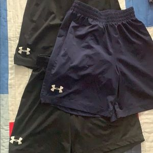 Under Armour size YSM shorts. Three pairs